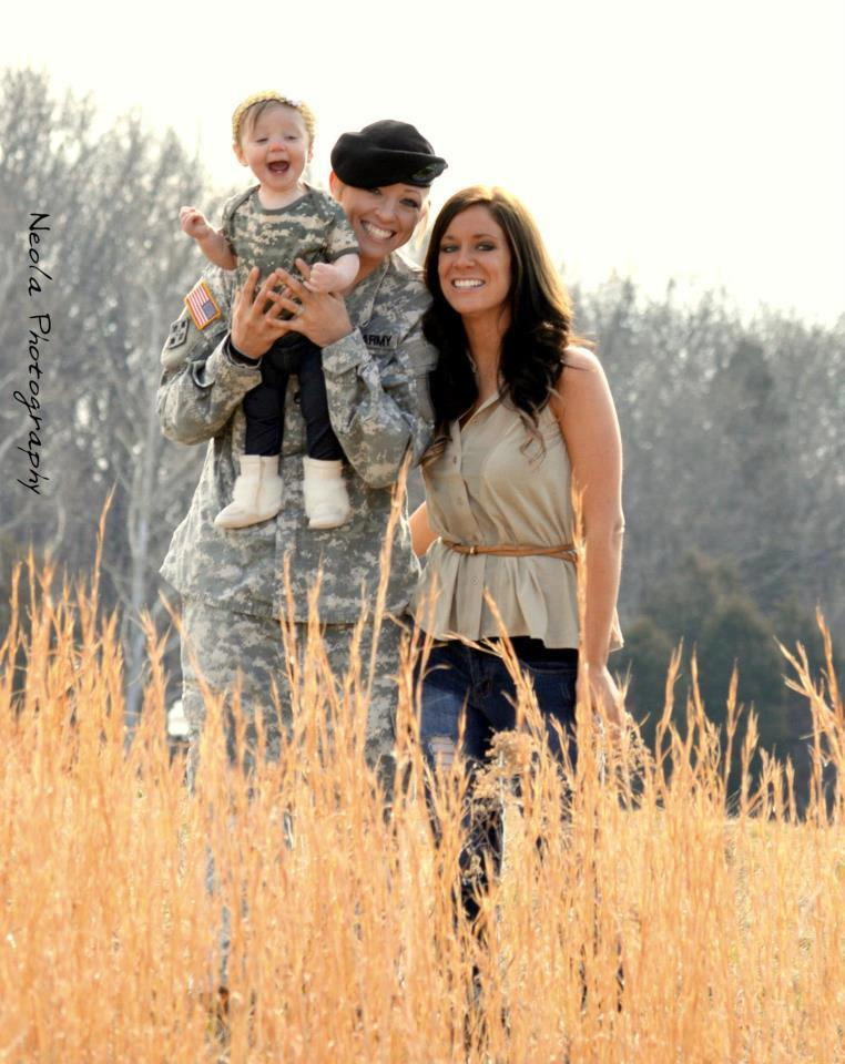 "American soldier Jessica Hanna posing with her family.  Photo via American Military Partner Association. ""You don't have to be straight to fight and die for your country.  You just have to shoot straight.""  — Barry Goldwater"