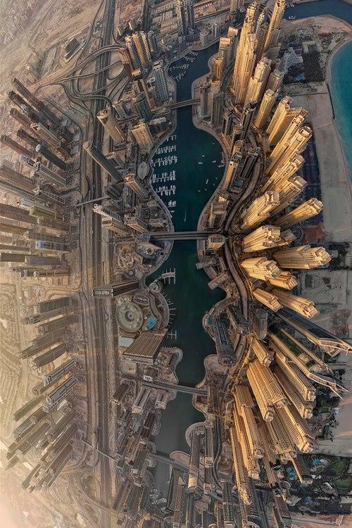 Dubai Marina, United Arab Emirates. Below and to the right is a series of man-made islands in the shape of a palm tree. Further in that direction is a series of man-made islands in the shape of the continents of Earth. Above and to the right is yet another palm tree. – waegen (via – waegen, parisjardin)
