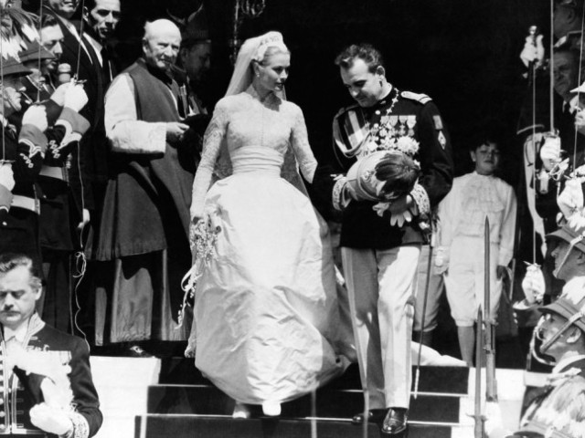 Grace Kellyon her wedding day to Prince Rainier III of Monaco in 1956. Her dress is still considered one of the most beautiful in history, and was created by MGM costume designer Helen Rose, who had previously worked with Grace on two of her movies, and comprised 25 yards of silk taffeta and 100 yards of silk net. The fitted bodice was made of Brussels lace. #Grace Kelly #Princess Grace Kelly  #Prince Rainier III of Monaco  #Princess Grace Kelly of Monaco #Beautiful People #Black and White #Wedding#Wedding Dress#1956#1950s