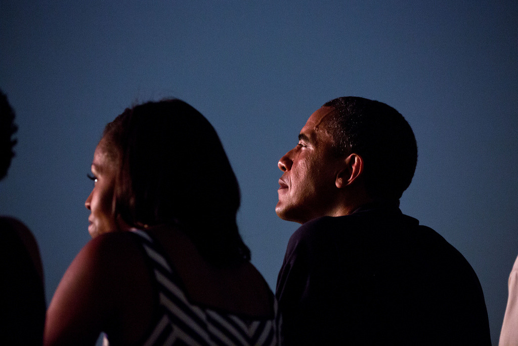 President Barack Obama and First Lady Michelle Obama watch from the White House roof as fireworks erupt over the National Mall, July 4, 2012. (Official White House Photo by Pete Souza)  Most iconic Pete Souza photos of Obama family's first 4 years in the White House