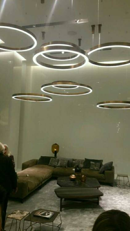 A contemporary sectional with circular lights