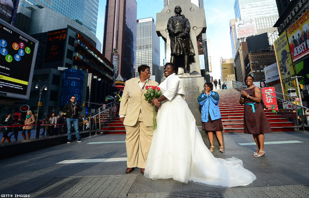 Renee and Chris Wiley pose for a wedding photo on Times Square in New York CIty on Wednesday. Congratulations to the happy couple! (EMMANUEL DUNAND/AFP/Getty Images)