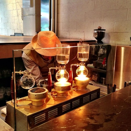 Michael preparing the #siphon #coffee @ #bluebottlechelsea #bluebottle  (at Blue Bottle Coffee)