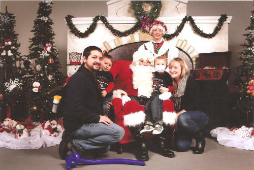 Photo of our family with Santa Claus!  I still cannot understand how he fits so many visits into his December schedule!?!  This was taken at the Jay Fund Christmas Party (previous post).  They were kind enough to mail us a copy of the photo.