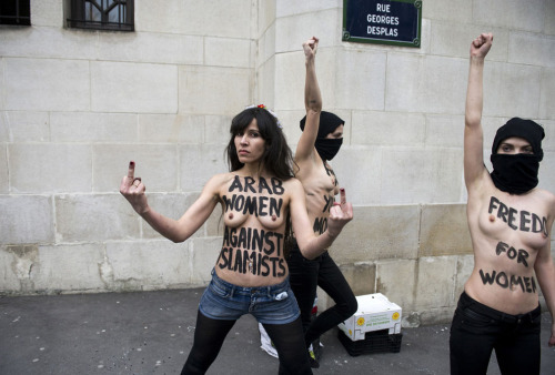 politics-war:  Topless Femen activists protest against Islamists in front of the Great Mosque of Paris, on April 3, 2013. Photo: Fred Dufour
