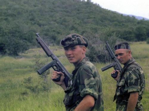 45-9mm-5-56mm:  gunrunnerhell:  Thompson Two soldiers with the venerable Thompson M1A1. This was taken in Vietnam at the MACV Recondo School. It was a specialized training course designed to create special reconnaissance and commando (hence Recondo) units that would infiltrate and operate behind enemy lines.  (via TumbleOn)