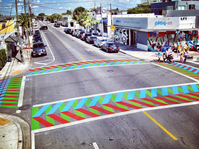 MIAMI – Residents and visitors of Wynwood can now enjoy the neighborhood's first permanent artistic crosswalk, marked by a work that seeks to transform the intersection of Northwest Second Avenue and 25th Street. The effort is part of the Miami Biennale and WADA's 'Wynwood Ways', a collaboration to make the neighborhood a more pedestrian-friendly cultural destination. -Source: Wynwood