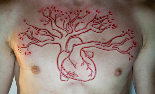 velvet-crowbar:  trashika:  ugh-sad:  boyslut:  Scarification is so pretty but I bet it hurts like a bitch   ♡pale blog♡  Ciao  i want a small one somewhere on my arm or tights or somewhere but yeah the pain