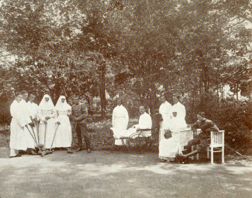 Grand Duchesses Olga and Tatiana playing croquet with their mother and some wounded soldiers from their hospital at Tsarskoe Selo: c. 1915.