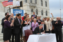 fuckyeahrhodeisland:  Governor Chafee signs same-sex marriage in Rhode Island into law Thursday on the steps of the State House.