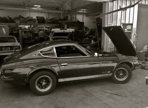 My bipolar Datsun Z mainlining her meds at the mechanic. ECT is next.