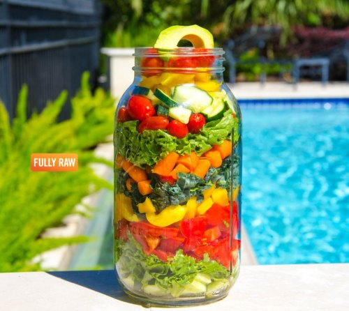 "rawlivingfoods:  ""Check out my FullyRaw Salad in a Jar! It's a meal on-the-GO and ready to eat for later! Simply pour in dressing, shake, and mix or pour it into a bowl and enjoy! I've layered my favorite salad ingredients (listed below) and placed them into a 64 oz jar. Keeping the salad in a jar makes it not only travel-friendly, but also keeps it air-tight and super fresh! Eating healthy has never been as fun or easy! Who's excited to try this one?!"" Ingedients:  Cucumbers  Green Leaf Lettuce  Beefsteak Tomatoes  Colorful Bell Peppers  Lacinato Kale  Carrots  Cherry Tomatoes  Avocado Dressing Recipe Here"