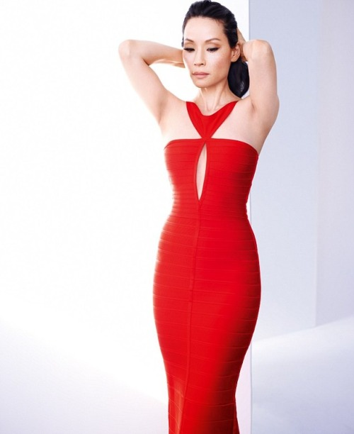 Lucy Liu wearing a red bandage dress by Hervé Léger