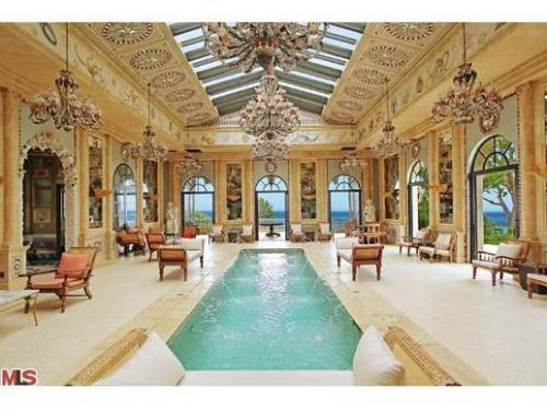 """Of all the magnificent houses in the Los Angeles-area for sale right now, La Villa Contenta in Malibu is a front-runner for the grandest indoor pool."" (via LA Times: Grandest pool around? Malibu has the one to beat) Definitely click through to check out the slideshow on this one. It's beyond crazy - the property appears to have at least three or four pools! Oh, and its only $65,000 a month to rent this summer, so if you were looking for a place to crash near the beach on the cheap, see if you might be able to land the job as poolboy here…"