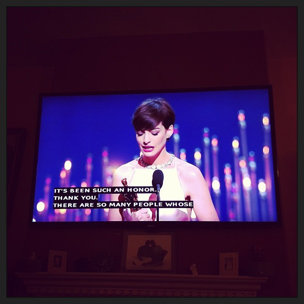 Anne Hathaway looks stunning in #Prada accepting her Best Supporting Actress for Le Mis. #Oscar #BestDressed.