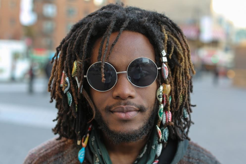 "humansofnewyork:  ""Bottlecaps, crystals, and feathers."""