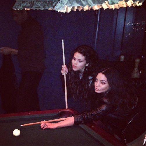Selena and Vanessa playing billiard
