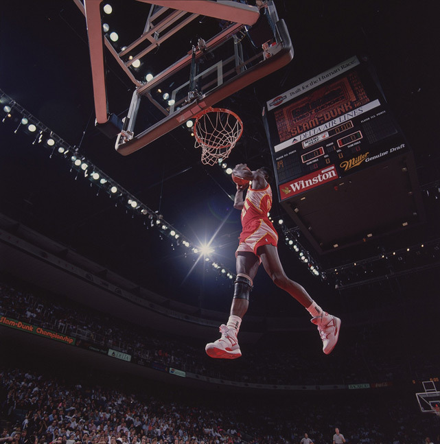 Dominique Wilkins competes at the 1988 Slam Dunk Contest. Despite Wilkins' amazing work, the contest was won by Michael Jordan. (Walter Iooss Jr/SI)
