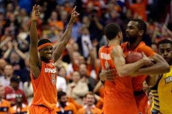 nbcnews:  Syracuse moves on to Final Four, beats Marquette 55-39 (Photo: Getty Images) WASHINGTON, D.C. — James Southerland led the way with 16 points and Michael Carter-Williams played a fantastic floor game as No. 4 seed Syracuse knocked off No. 3 seed Marquette 55-39 in the Verizon Center to advance to the Final Four on Saturday night. Read more from NBC Sports.  My bracket is screwed so badly this year.