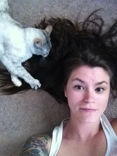 i laid down and Ripley decided to take the opportunity to play with my hair.  ouch.