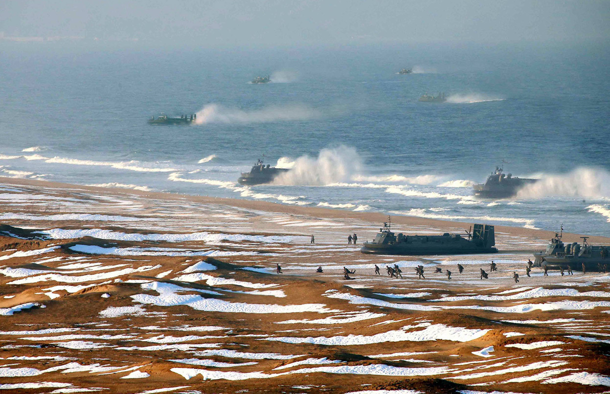From Is This North Korean Hovercraft-Landing Photo Faked?.  A picture released by North Korea's official Korean Central News Agency (KCNA) on March 26, 2013 appears to show evidence of digital manipulation, specifically the cloning of at least two hovercraft, to make it appear as if more vehicles were involved in a recent military exercise. The original caption: This picture released by North Korea's official Korean Central News Agency on March 26, 2013 and taken on March 25, 2013 shows the landing and anti-landing drills of KPA Large Combined Units 324 and 287 and KPA Navy Combined Unit 597 at an undisclosed location on North Korea's east coast. (KCNA Via KNS/AFP/Getty Images)