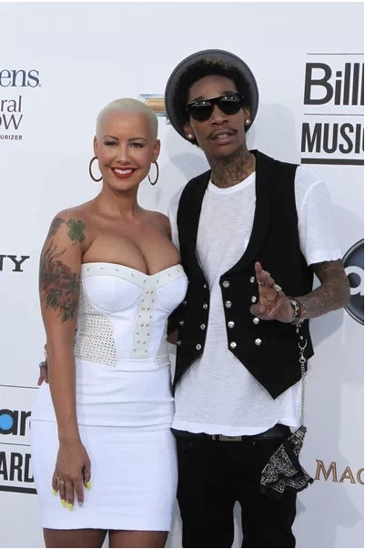 Well, this one snuck by us. Apparently, Amber Rose and Wiz Khalifa got married! Click the pic for details!