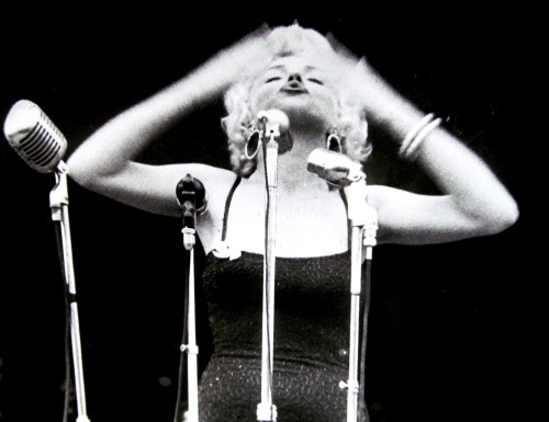 missingmarilyn:  Marilyn Monroe blowing a kiss after performing for U.S. troops stationed in Korea, 1954.