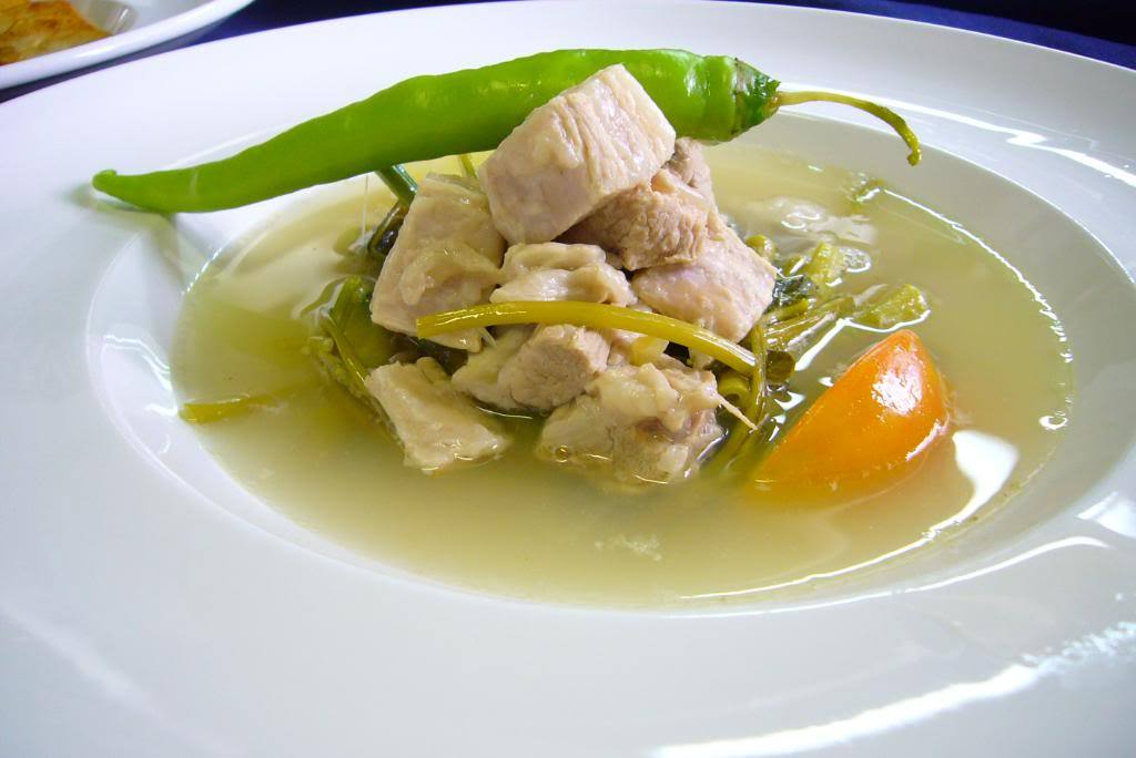 #FilipinoEats Recipe  Sinigang con Limon / Sinigang na Baboy It's one of my favorite Filipino dishes.A tart (tamarind based) like soup. With your choice of pork, beef, shrimp or fish. Get creative with it. I'm thinking of making this for Super Bowl Sunday for my dad & BF. Here's a recipe I found minus the boring old mix aka… MSG. http://qwekqwek.com/cuisine/filipino-cuisine-2/sinigang-con-limon RECIPE:  3 lbs pork ribs, cut into serving pieces (Ask the butcher to do it)   2 medium size tomatoes, chopped   2 medium size onion, chopped   Juice of 3 lemons and 2 limes    8 cups water   1 bag of washed fresh spinach    1 medium size eggplant   15 pieces okra   2 fresh green finger pepper, whole   1 tablespoon cooking oil   1 tablespoon fish sauce (patis)   Salt and pepper  To clean the pork by removing scum and reduce a little fat oil, put the pork in a pot with water, just enough to cover the meat, and bring to a quick boil on high heat. Leave it boiling for 5 mins, then drain. Rinse your meat in running water to clean it thoroughly. In the same pot, sauté garlic, onion and tomato for 2 mins Add cleaned pork, season with salt and pepper and cook till brown. Add water and lemon/lime juice.  Make sure no seeds get into the pot unless you want a bitter broth Bring to a boil and cook until pork is tender, when the meat is starting to peel off from the bone. Add eggplant, okra and fish sauce. Cook for 4 mins. Add spinach and whole finger peppers. Cook for another 4 mins