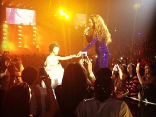 Blue Ivy Carter, tallest sixteen-month-old ever, got onstage with Beyonce at her concert last night. Because the Carters want Blue's life to be private, except when they can create a spectacle. UPDATE: Not Blue Ivy. Just a fan. Because people bring toddlers to Beyonce concerts.