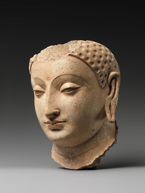malebeautyinart:  Head of Buddha, stucco with remains of paint, from Afghanistan 5th - 6th century