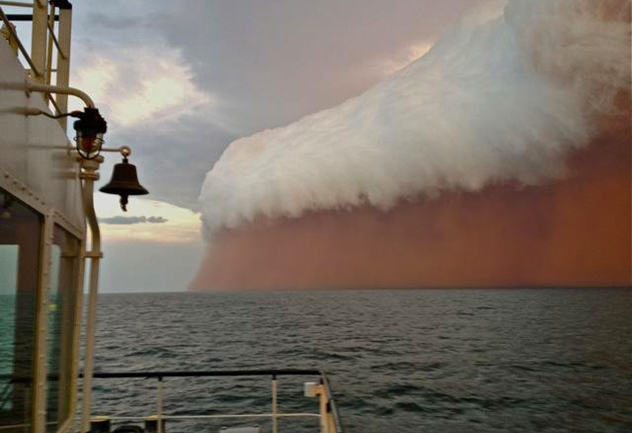 From Summer Down Under, one of 31 photos. A white shelf cloud caps brownish dirt from a dust storm, or haboob, as it travels across the Indian Ocean near Onslow on the Western Australia coast in this handout image distributed by fishwrecked.com and taken January 9, 2013. (Reuters/Brett Martin/fishwrecked.com)