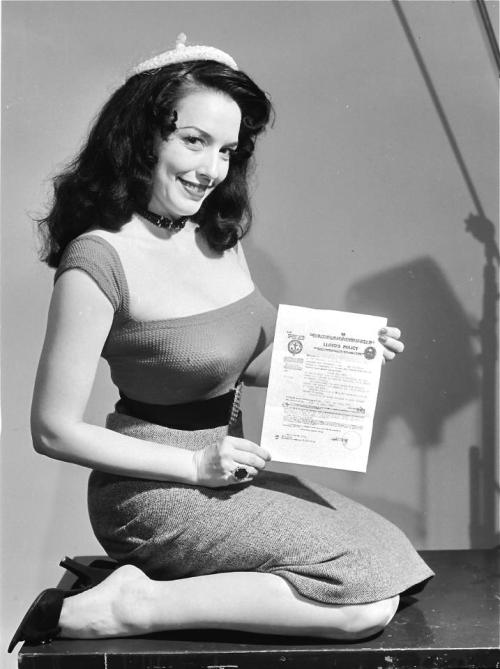 "elevenacres:  Evelyn West poses with the policy she took out with Lloyd's Of London, insuring her breasts for $50,000.. A publicity stunt that allowed her to use ""the $50,000 Treasure Chest"" tag, in all of her subsequent Burlesque appearance promotions.."