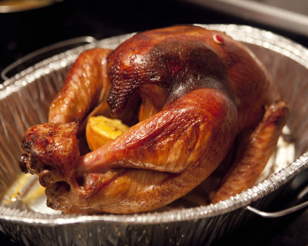Drunken British Bucket Turkey Or otherwise known as Orange Bourbon Tea Brined Turkey roasted with Molasses Bourbon Orange Butter. Just… wow. Anyway, follow the directions here for the brine, then follow these easy steps to inject your turkey full of goodness to bake. Ingredients: Brined turkey 1 stick of butter Zest and juice of 1 orange 1/4 cup bourbon 1/4 cup molasses Cayenne pepper Salt 2 springs of rosemary 2 bay leaves Put the butter, orange zest, half the orange juice, bourbon, molasses, cayenne pepper, and salt in a blender.  This works better if the butter is at room temperature, but whatever.  Blend.  It may not combine entirely, but that's ok.  Refrigerate it for a bit if you need to. Make a pocket under the turkey skin, and mash the butter mixture all up in there.  Put 1 bay leaf and 1 sprig of rosemary on each side, over the breast.  Squeeze the remaining orange juice over the skin, and season the outside, and the cavity of the bird, with salt and pepper.  Stuff the orange rind into the cavity, and bake for however long a bird of the size you have needs to bake.  Cover it for the first 3/4 then remove the cover for the last 1/4.  Let it rest for 30 minutes, covered, before serving.
