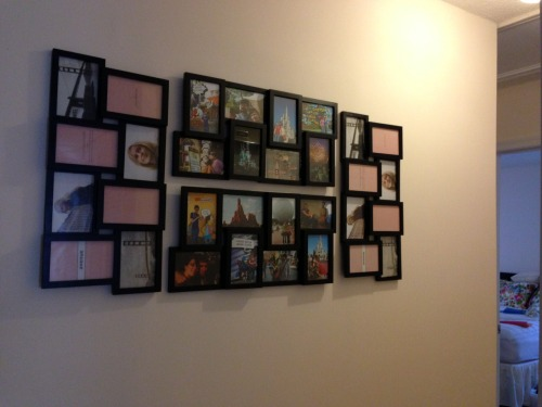 Saturday night project: Finally hanging the set of picture frames we bought almost two years ago. We only wanted two at the time, but I thought four would look better hanging on the wall when we eventually got a house. Nearly a year after moving in, they're finally on the wall. And now we need to get more photos printed asap, because there's a strange blonde woman and sideways photos of San Francisco on my wall.