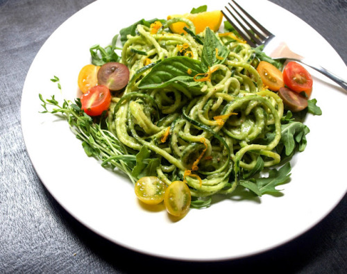 Raw Vegan Zucchini Pasta with Avocado & cucumber sauce   Ingredients 1 large zucchini (1 per person) grape, cherry or mini heirloom tomatoes, halved jalapeno, thinly sliced and seeds removed (optional) arugula pea shoots (optional) zest of one meyer lemon or regular lemon Avocado-Cucumber Puree 1 medium avocado 1 cucumber, peeled and sliced thick a few large leaves of basil (optional) 1 meyer lemon or regular lemon, juice of 2 garlic cloves 1/4 teaspoon white pepper or black pepper to taste salt to taste Prepare your zucchini noodles julienne style or spiralized. Or alternately, cook your pasta of choice, about 8 ounces.For the puree, place all ingredients into a food processor/blender and process until creamy. Taste for flavor adding anything extra you might like.Toss zucchini pasta with avocado-cucumber puree and a handful of arugula. Serve with tomatoes, peas shoots, jalapenos, lemon zest, lemon wedges and fresh cracked pepper.