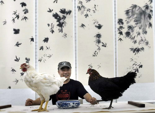 After seeing a couple of chickens walking on paper at a studio in Songzhuang, Beijing, Chinese painter Xiau Hu bought two chickens himself at a market, painted their claws with ink and let them walk on sheets of white paper to make paintings.  Source: China Daily
