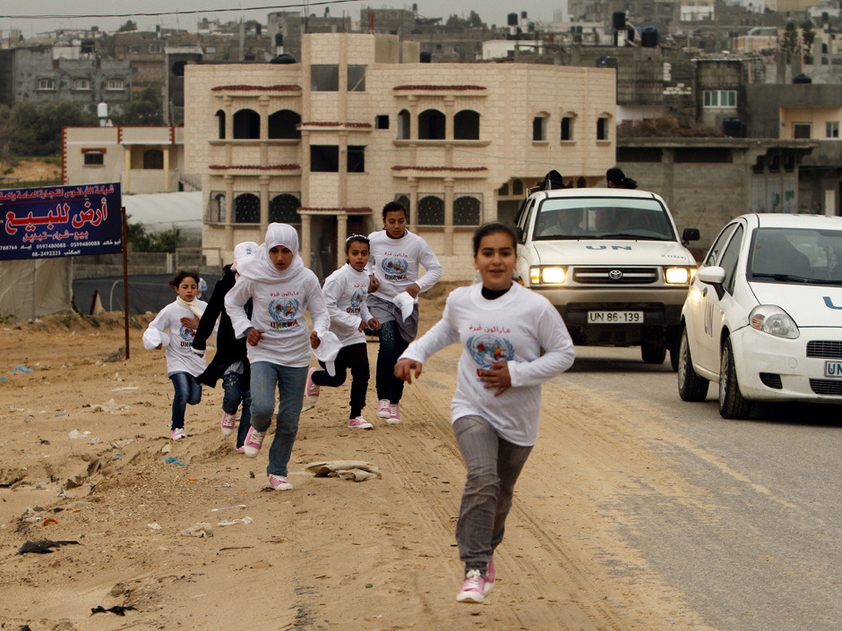 "A U.N aid agency canceled the Gaza marathon on Tuesday after the Palestinian territory's militant Hamas rulers banned women from participating in the annual sporting event.UNWRA, which assists Palestinian refugees and also sponsors and organizes the event, announced that plans for the race next month have been scrapped because of the Hamas demand that women be barred.""We regret this decision to cancel the marathon but we don't want men and women running together,"" Abdessalam Siyyam, a Hamas government official, told Agence France-Presse.""We did not tell Unrwa to cancel the marathon and we haven't prevented it, but we laid down some conditions: We don't want women and men mixing in the same place."" (Photo: Mohammed Abed/AFP/Getty Images)"