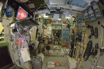 "A Glimpse at Where Camera Gear is Kept on the International Space Station  If you're a photography enthusiast and ever have the good fortune of finding yourself floating around on the International Space Station, here are two words you should know: service module. Formally called the ""Zvezda Service Module,"" it's the component of the ISS that houses all of the station's life support systems, and is where the astronauts gather if there is any kind of emergency. But here's the main reason you'll want to pay the module visit: the fancy camera equipment used by the astronauts is stored on the walls!  (Continue Reading)"