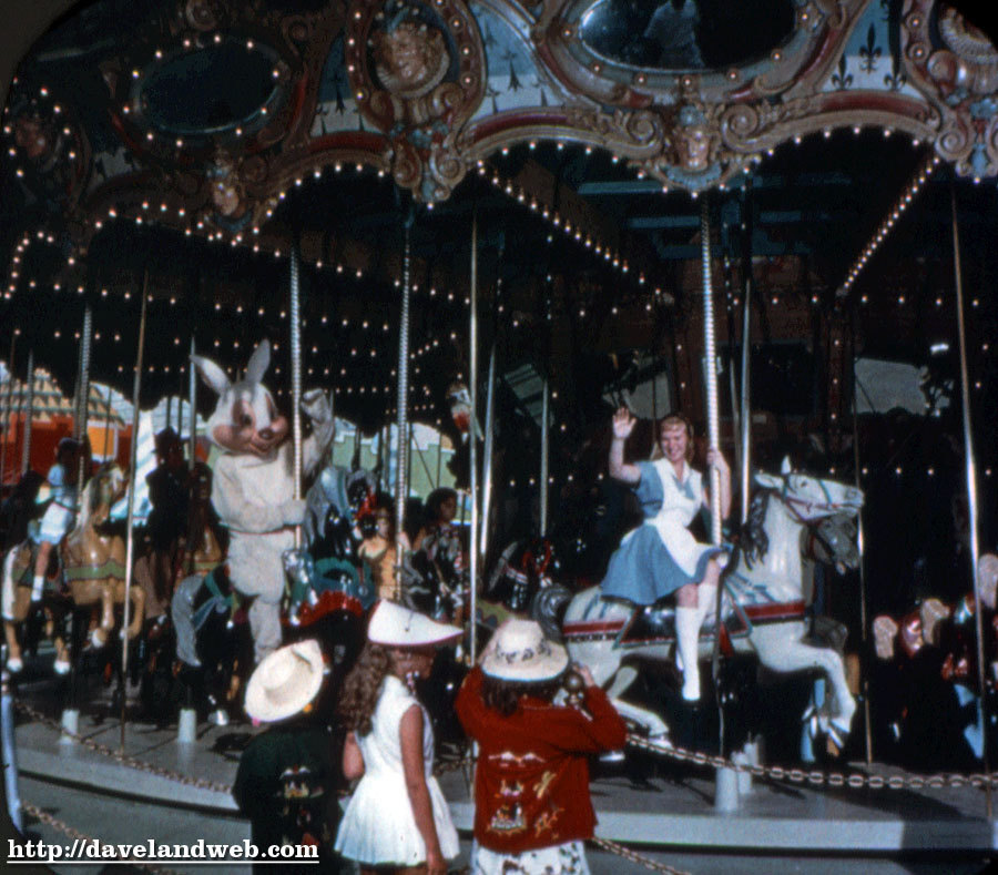 Alice and the White Rabbit take a spin on the Carousel.