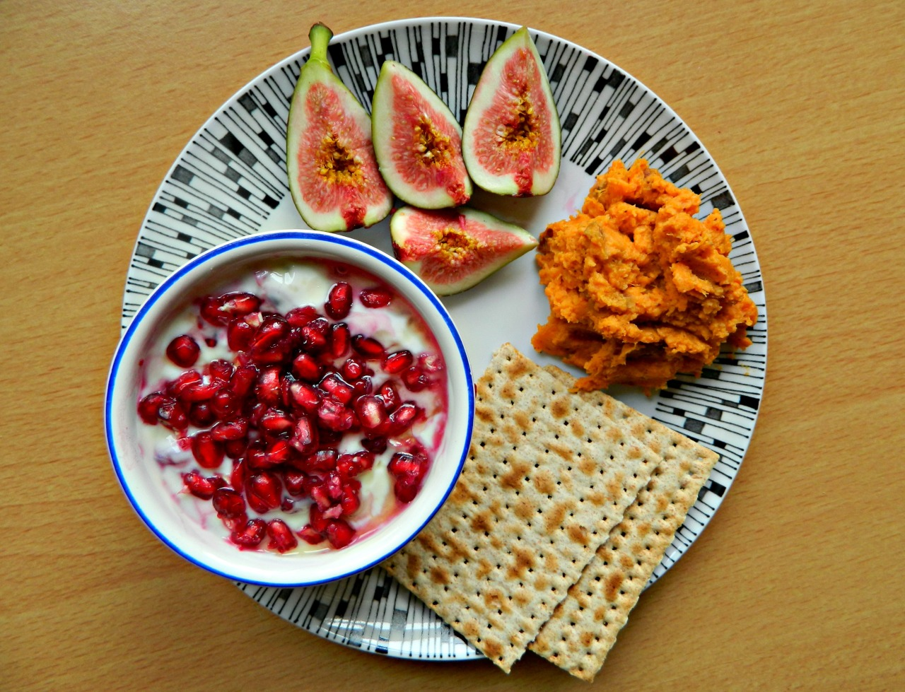 Soy yoghurt with half a pomegranate, sweet potato and almond butter mash, a fig and some spelt crackers. If you haven't tried this already - do it. Mash sweet potato (skins on) with some almond butter, maple syrup, almond milk and a bit of dairy free butter/spread. It will change your life. Probably.