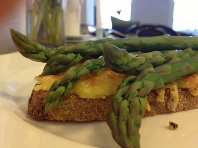 Asparagus on eggy cheesey toast  One egg yoke mixed with a little grated gruyere and salt and pepper. Piled on sourdough toast, grilled and topped with steamed asparagus. YUM.