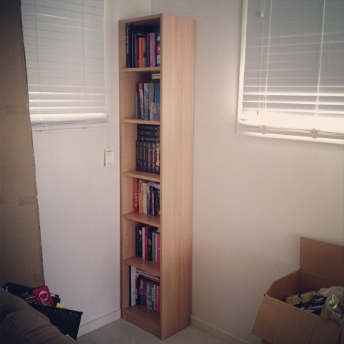 My Easter Present - bookcase one of two is put together and full of books!!! I'M SO HAPPY, SERIOUSLY YOU HAVE NO IDEA HOW LONG I'VE WAITED FOR A NICE BOOKCASE TO FIT ALL MY BOOKS!!! #mybookshaveahome #ihadanxietyaboutleavingtheminboxes #imweird
