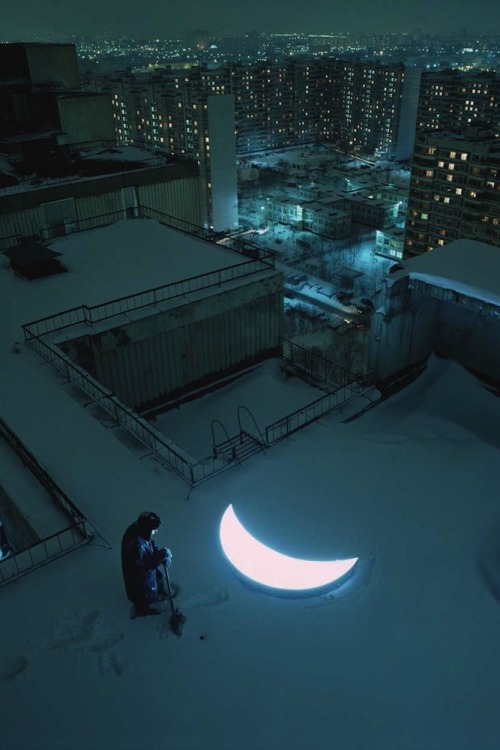 "Private Moon by Leonid Tishkov This captivating mobile art installation and visual poem tells the tale of ""a man who met the moon and stayed with her forever"". Russian artist Leonid Tishkov has travelled all over the world with the illuminated moon for ten years capturing unique moments in unexpected places in a wide variety of countries.  ""The moon is a shining point that brings people together from different countries, of different nationalities and cultures. And everyone who gets in its orbit does not forget it ever. It gives fairytale and poetry in our prosy and mercantile world.""       Artists: 