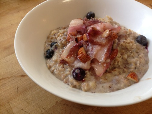 fueledbyplants:  blueberry banana oats topped with grilled peaches and almonds