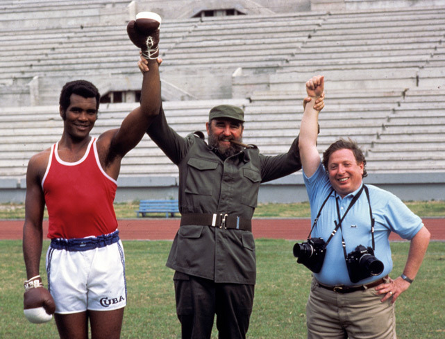 Cuban President Fidel Castro poses with heavyweight boxer Teofilo Stevenson and SI photographer Neil Leifer during a photo shoot before the 1984 Summer Olympics. (Neil Leifer/SI)