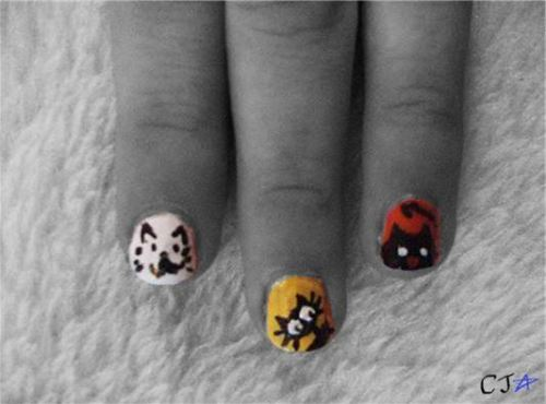 first ever go at nail art :D(can't take any credit for the designs of these ones as they were pinched off the internet)