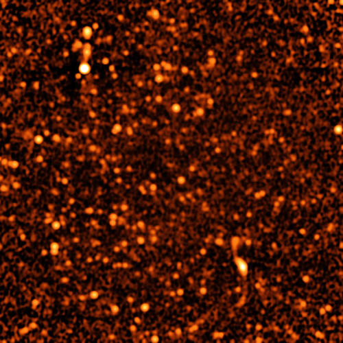 thenewenlightenmentage:  Deep, Detailed Image of Distant Universe Apr. 30, 2013 — Staring at a small patch of sky for more than 50 hours with the ultra-sensitive Karl G. Jansky Very Large Array (VLA), astronomers have for the first time identified discrete sources that account for nearly all the radio waves coming from distant galaxies. They found that about 63 percent of the background radio emission comes from galaxies with gorging black holes at their cores and the remaining 37 percent comes from galaxies that are rapidly forming stars. Continue Reading