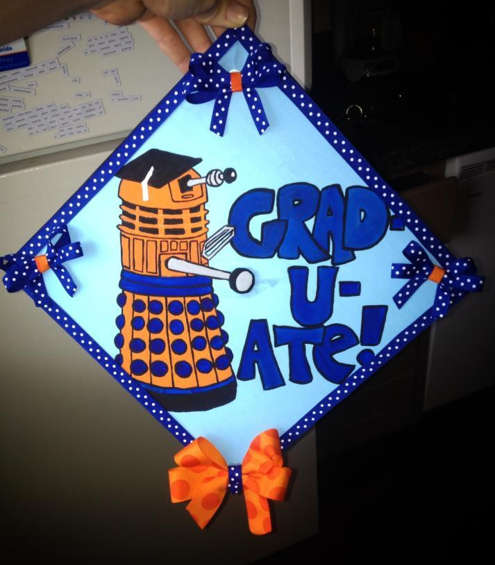 daringartisticadventurer:  My graduation cap. Done up in my school's colors. I'm a little too nerdy for my own good…