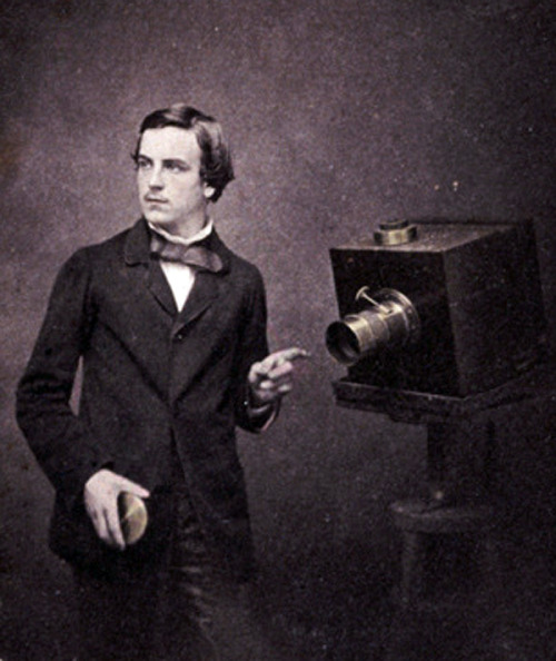 "mydaguerreotypeboyfriend:  Walter Bentley Woodbury, age 23. Self-portrait with a camera, 1857. This British-born photographer sailed to Austraila when he was twenty and ran a sucessful photography studio first in Melbourne, and then in Java, Indonesia.  He enclosed this photograph with a letter to his mother:    ""The portrait I send has the date marked on it and in the future I shall always date them so that you can see if I improve in appearance or otherwise."""