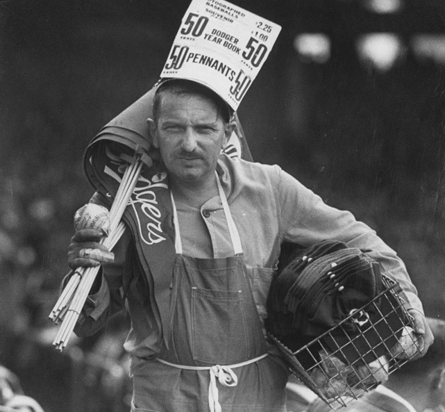A vendor sells souvenirs during the 1952 World Series between Yankees and Dodgers. (Mark Kauffman/SI)